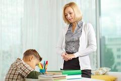 Boy and his tutor Stock Photos