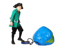 Boy in historical dress pumping inflatable globe Royalty Free Stock Image
