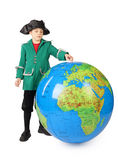 Boy in historical dress standing with big globe Stock Image
