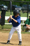 Boy Hitting Ball Stock Images