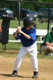 Boy Hitting Ball Stock Images