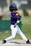Boy hitting baseball Stock Photos