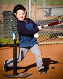 Boy hitting baseball Stock Photo