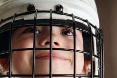 Boy in hockey helmet Stock Photos