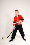 Boy in hockey stance royalty free stock photo