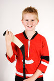 Boy with hockey stick Royalty Free Stock Photography