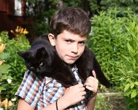 Boy hold black cat as a collar Stock Photo