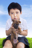 Boy hold puppy Stock Photography