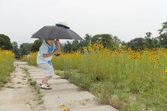 Boy hold umbrella Royalty Free Stock Image