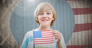 Boy holding american flag against hand drawn american flag with flare Stock Photography