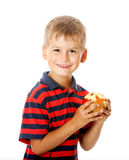 Boy holding an apple Royalty Free Stock Photos