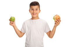 Boy holding apple and a sandwich Royalty Free Stock Photo