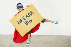 Boy holding asign with Dream Big Royalty Free Stock Photos
