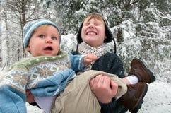 Boy Holding Baby Stock Photos