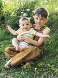 Boy  holding baby boy brother Royalty Free Stock Photo