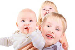 Boy is holding baby. girl is standing behind Royalty Free Stock Photo