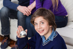 Boy holding a ball of the christmas tree Royalty Free Stock Image