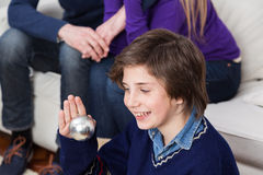 Boy holding a ball of the christmas tree Stock Photo