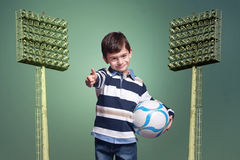 Boy holding a ball Royalty Free Stock Photography
