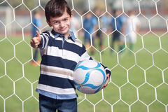 Boy holding a ball Stock Images