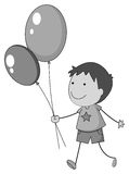 Boy holding balloons in hand Royalty Free Stock Photography