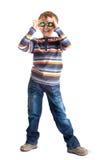 Boy holding balls to eyes Stock Photos