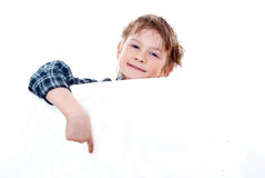 Boy holding a banner. Royalty Free Stock Image