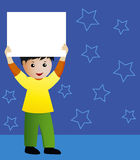 Boy holding a banner. A cute Caucasian boy is holding a banner over his head. He is standing in a room with blue floor and walls decorated with stars Stock Photos