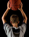Boy holding basketball Stock Photo