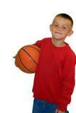 Boy Holding Basketball. Young boy in red sweatshirt holding a basketball Stock Photos