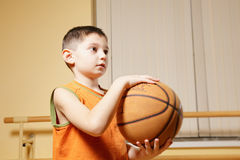 Boy holding basketball Royalty Free Stock Images