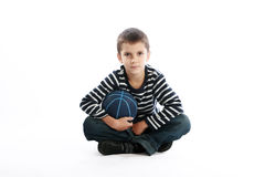 Boy holding basketball ball Stock Photo