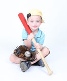 Boy holding a bat with ball and glove Stock Photography