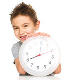 Boy is holding big clock Royalty Free Stock Image