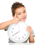 Boy is holding big clock Stock Photography