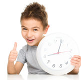 Boy is holding big clock Royalty Free Stock Photo