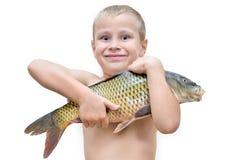 Boy holding big fish isolated on white background Royalty Free Stock Images