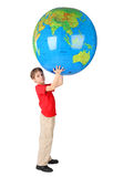 Boy holding big inflatable globe over his head Royalty Free Stock Photos