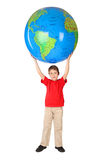 Boy holding big inflatable globe over his head Royalty Free Stock Photo