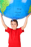 Boy holding big inflatable globe over his head Royalty Free Stock Photography