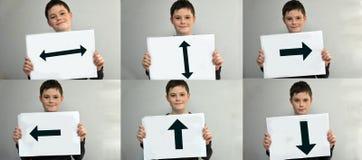 Boy holding billboard Stock Images