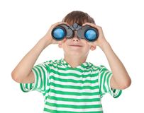 Boy holding binoculars Stock Photo