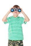 Boy holding binoculars Royalty Free Stock Image