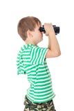 Boy holding binoculars Stock Image