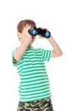 Boy holding binoculars Royalty Free Stock Photos