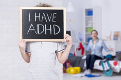 Boy holding blackboard. And admitting suffering from ADHD Stock Images