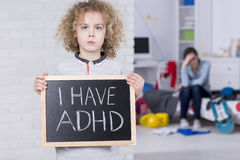 Boy holding blackboard. With `i have ADHD` text Royalty Free Stock Photography