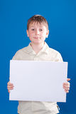 Boy holding a blank Royalty Free Stock Image