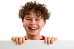 Boy holding blank board. Isolated on white background Royalty Free Stock Photos