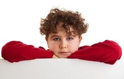 Boy holding blank board. Isolated on white background royalty free stock photo